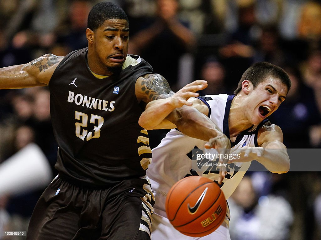 Chris Johnson of the St Bonaventure Bonnies and Kellen Dunham of the Butler Bulldogs battle for the ball at Hinkle Fieldhouse on February 6 2013 in...