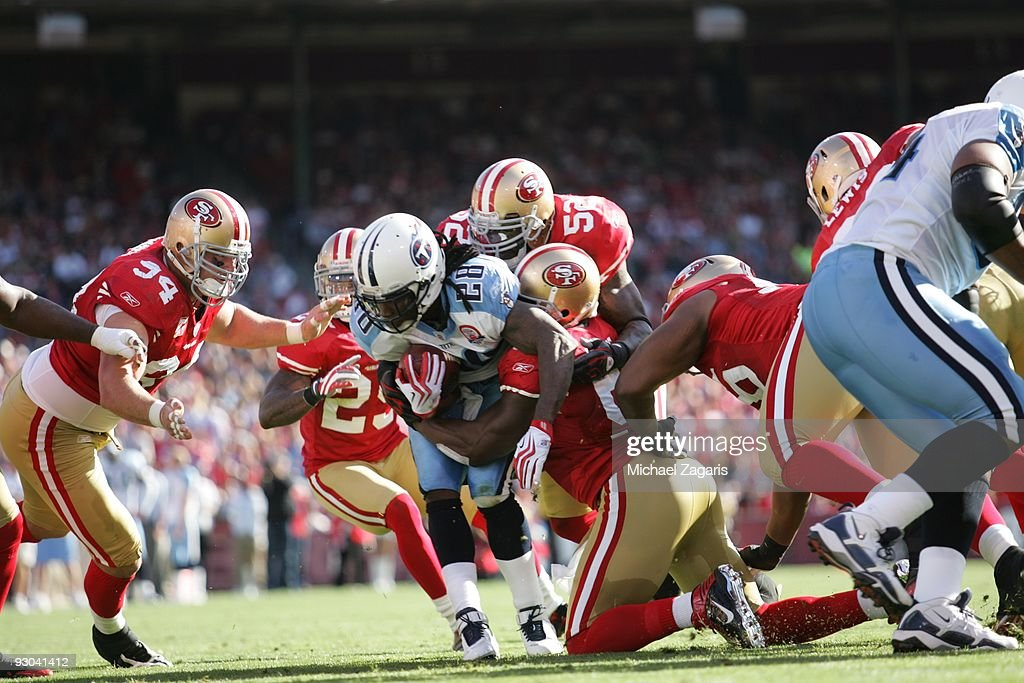 Chris Johnson of the Tennessee Titans is stopped by the San Francisco 49ers defense during the NFL game at Candlestick Park on November 8 2009 in San...