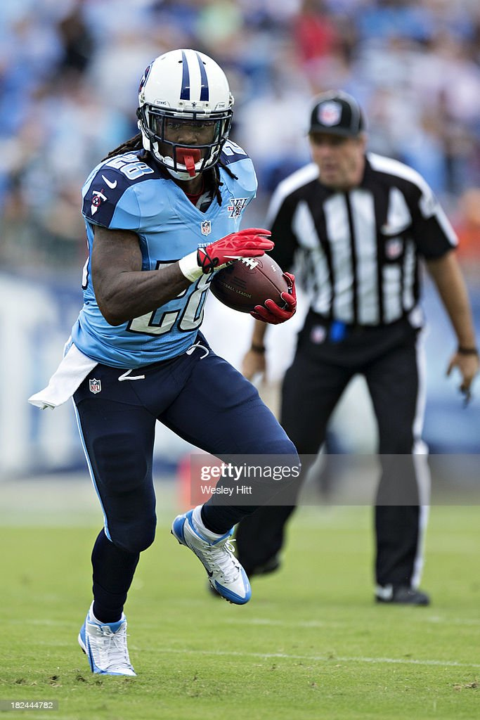 <a gi-track='captionPersonalityLinkClicked' href=/galleries/search?phrase=Chris+Johnson+-+American+Football+Running+Back&family=editorial&specificpeople=211438 ng-click='$event.stopPropagation()'>Chris Johnson</a> #28 of the Tennessee Titans runs the ball against the New York Jets at LP Field on September 29, 2013 in Nashville, Tennessee. The Titans defeated the Jets 38-13.