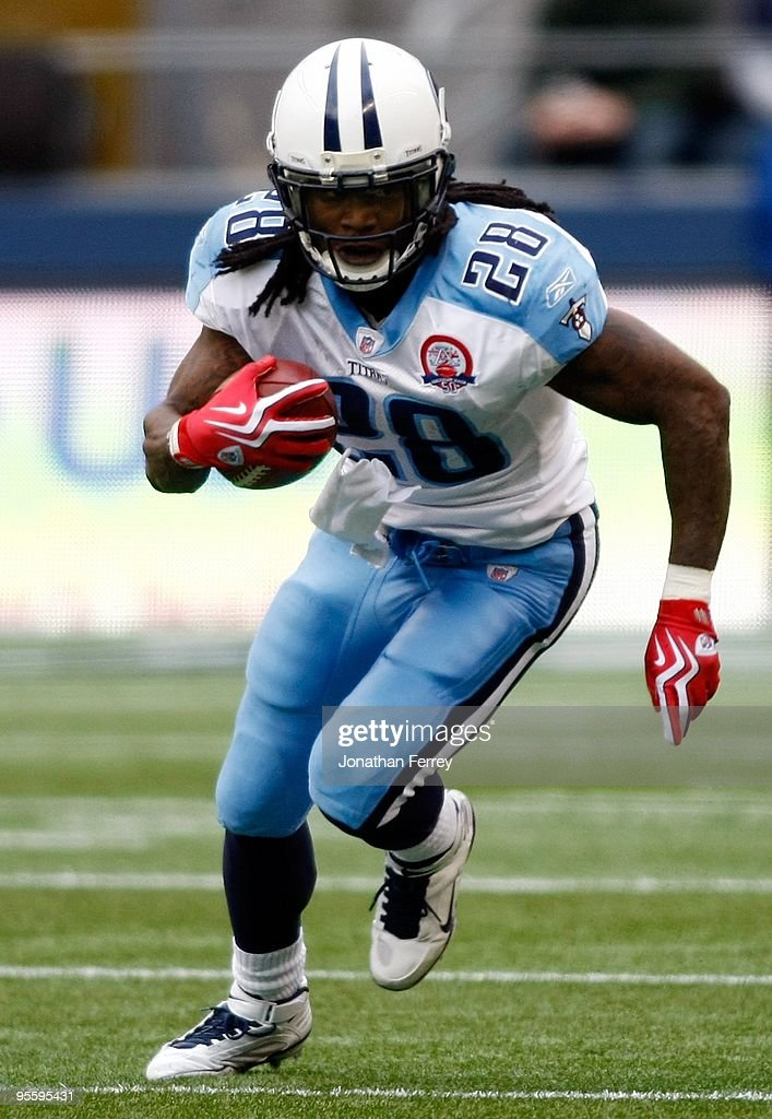 Chris Johnson of the Tennessee Titans runs with the ball against the Seattle Seahawks at Qwest Field on January 3 2010 in Seattle Washington Johnson...