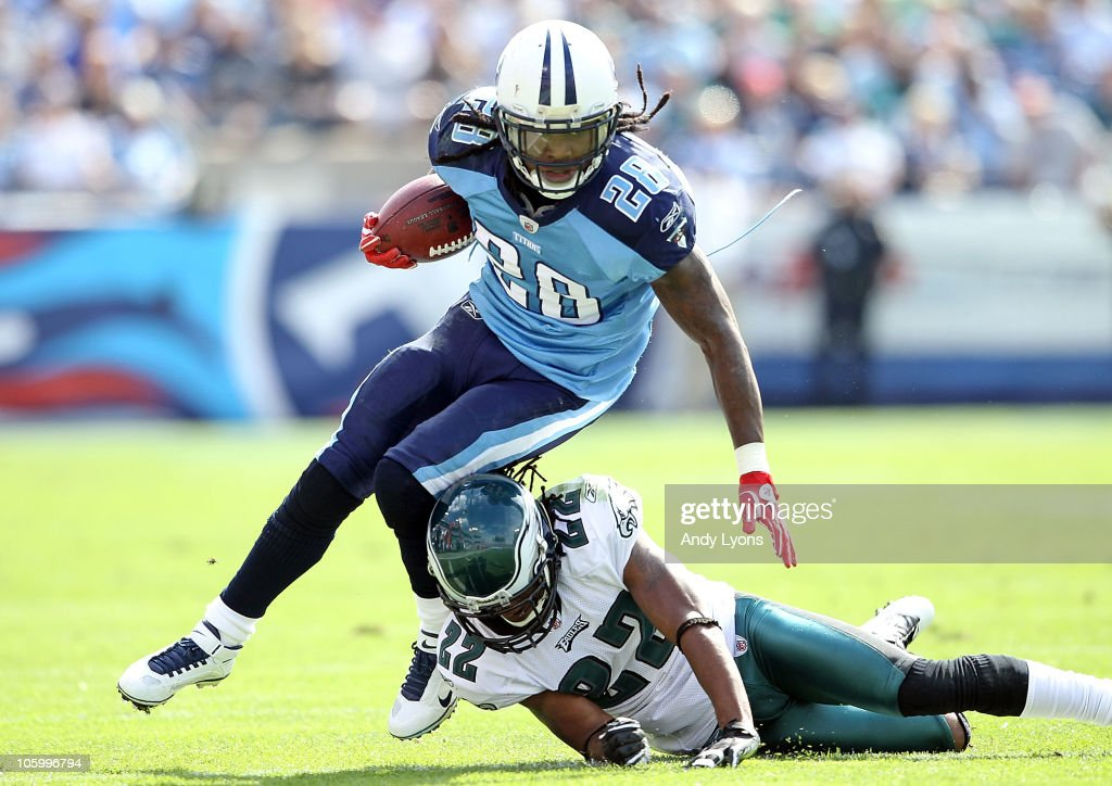 Chris Johnson of the Tennessee Titans runs with the while defended by Asante Samuel of the Philadelphia Eagles at LP Field on October 24 2010 in...