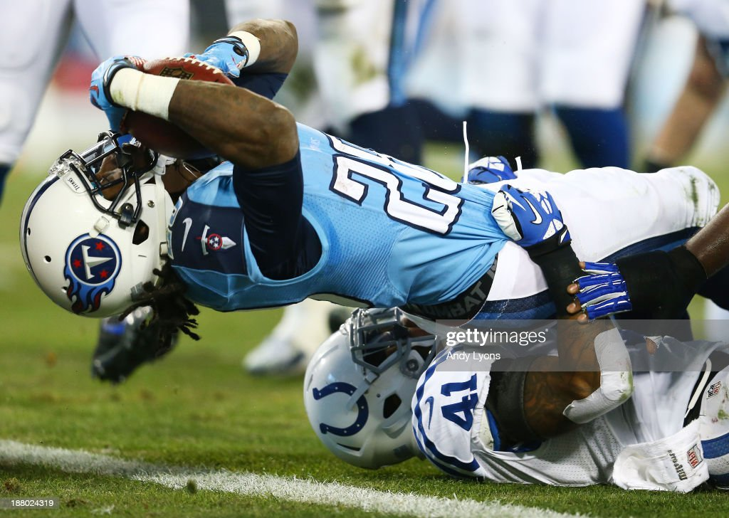 Chris Johnson #28 of the Tennessee Titans scores a first quarter touchdown against the defense of Antoine Bethea #41 of the Indianapolis Colts at LP Field on November 14, 2013 in Nashville, Tennessee.