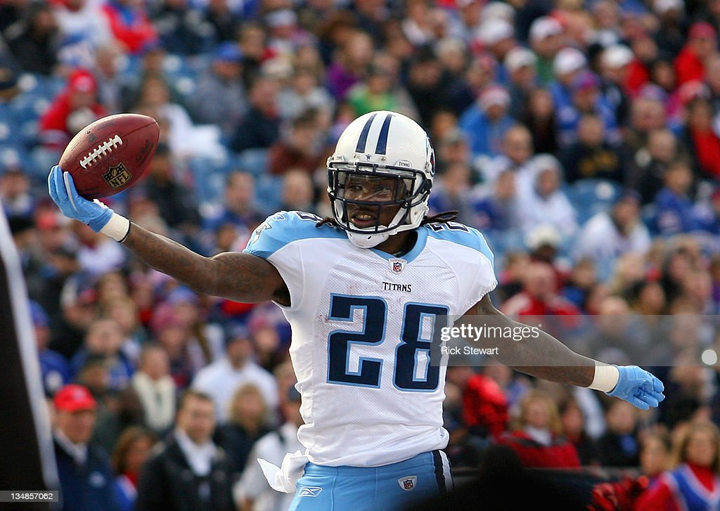 Chris Johnson of the Tennessee Titans scores his second touchdown of the game in the first half against the Buffalo Bills at Ralph Wilson Stadium on...