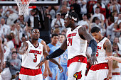 Chris Jones and Montrezl Harrell of the Louisville Cardinals celebrate during the game against the North Carolina Tar Heels at KFC Yum Center on...