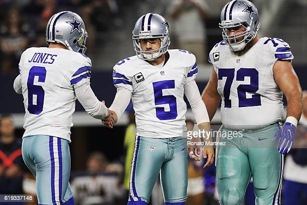Chris Jones Dan Bailey and Travis Frederick of the Dallas Cowboys celebrate during a game between the Dallas Cowboys and the Philadelphia Eagles at...