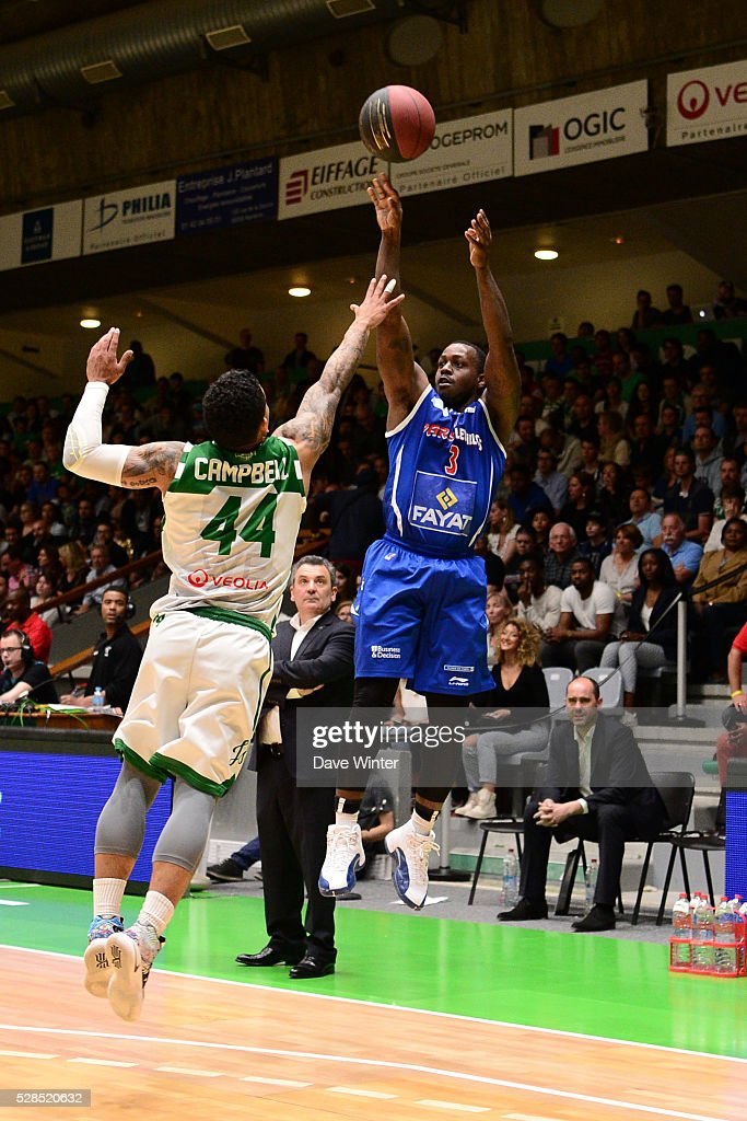 Chris Jones of Paris Levallois gets a shot off under pressure from TJ Campbell of Nanterre during the basketball French Pro A League match between Nanterre and Paris Levallois on May 5, 2016 in Nanterre, France.
