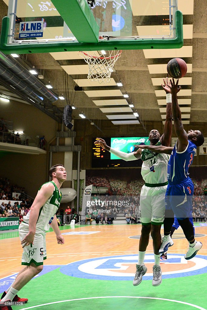 Chris Jones of Paris Levallois is blocked by Mouhammadou Jaiteh of Nanterre during the basketball French Pro A League match between Nanterre and Paris Levallois on May 5, 2016 in Nanterre, France.