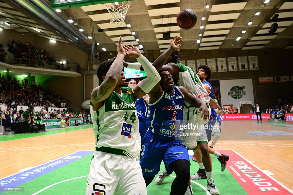 Chris Jones of Paris Levallois (centre) loses the ball trying to squeeze between TJ Campbell of Nanterre (left) and Mouhammadou Jaiteh of Nanterre (right) during the basketball French Pro A League match between Nanterre and Paris Levallois on May 5, 2016 in Nanterre, France.