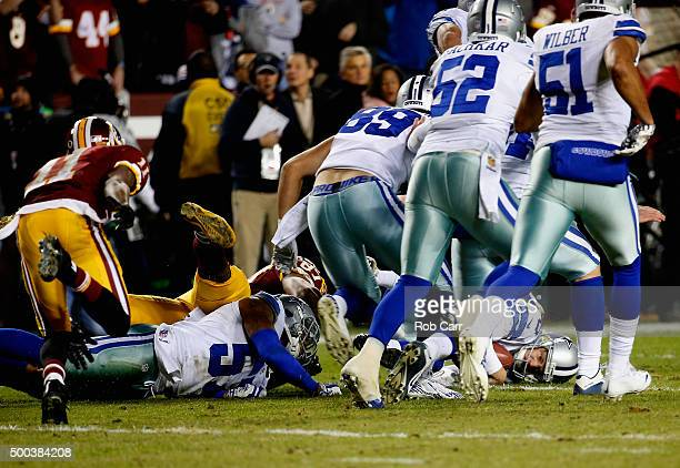 Chris Jones of the Dallas Cowboys recovers a fumbled punt by wide receiver DeSean Jackson of the Washington Redskins late in the second half of the...