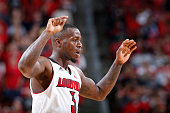 Chris Jones of the Louisville Cardinals celebrates against the Jacksonville State Gamecocks during the game at KFC Yum Center on November 17 2014 in...
