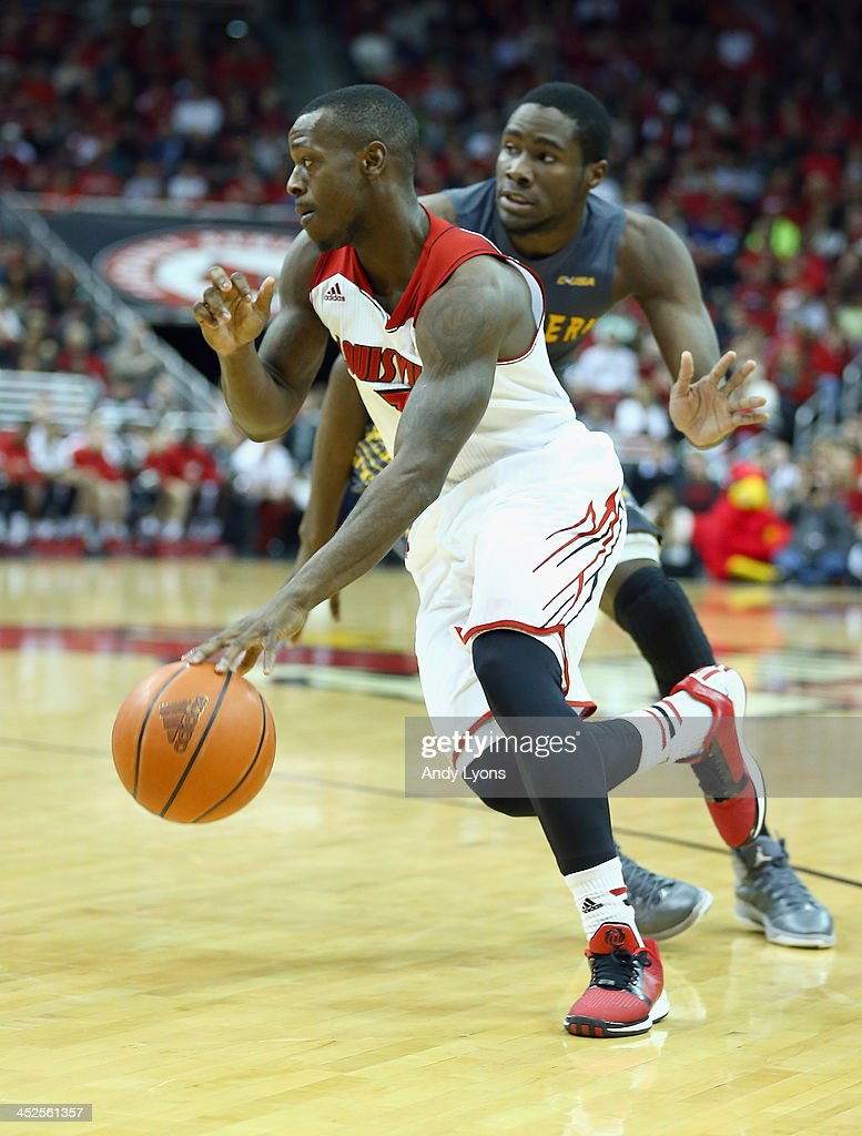 Chris Jones #3 of the Louisville Cardinals dribbles the ball during the game against the Southern Mississippi Golden Eagles at KFC YUM! Center on November 29, 2013 in Louisville, Kentucky.