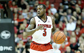 Chris Jones of the Louisville Cardinals dribbles the ball during the game against the Miami Hurricanes at KFC YUM Center on February 21 2015 in...