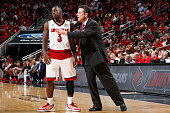 Chris Jones of the Louisville Cardinals listens to coach Rick Pitino during the game against the Jacksonville State Gamecocks at KFC Yum Center on...