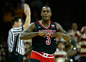 Chris Jones of the Louisville Cardinals reacts following a threepoint shot in the second half against the Boston College Eagles during the game at...