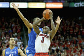 Chris Jones of the Louisville Cardinals shoots the ball while defended by Aaron Harrison of the Kentucky Wildcats during the game at KFC YUM Center...