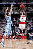Chris Jones of the Louisville Cardinals shoots the ball while defended by Marcus Paige of the North Carolina Tar Heels during the first half of the...