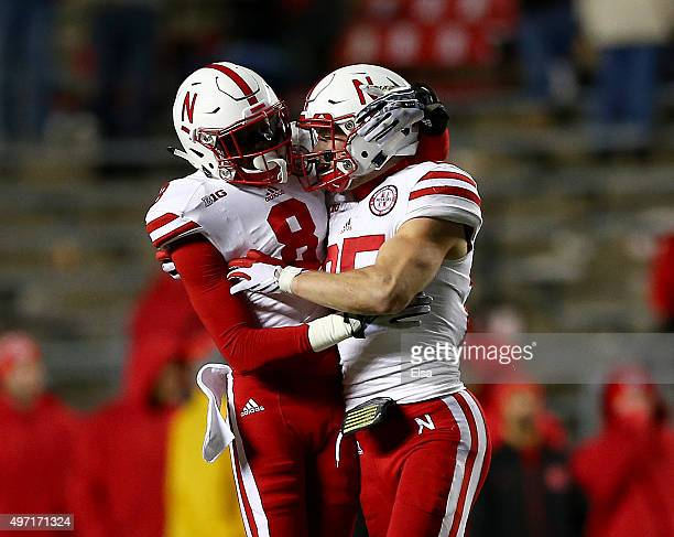 Chris Jones of the Nebraska Cornhuskers congratulates teammate Nate Gerry of the Nebraska Cornhuskers after he intercepted a pass in the final...