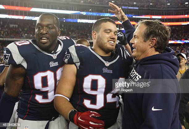 Chris Jones of the New England Patriots is congratulated by head coach Bill Belichick after blocking a field goal attempt in the final seconds of the...