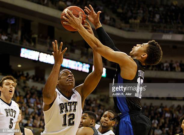 Chris Jones of the Pittsburgh Panthers and Derryck Thornton of the Duke Blue Devils battle for a rebound during the game at Petersen Events Center on...