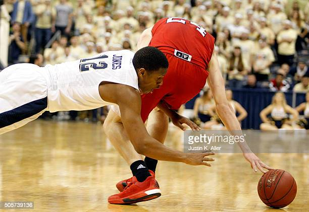 Chris Jones of the Pittsburgh Panthers and Maverick Rowan of the North Carolina State Wolfpack battle for a loose ball during the game at Petersen...