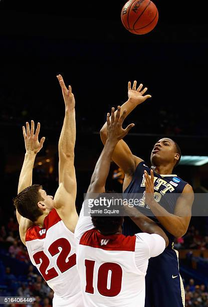 Chris Jones of the Pittsburgh Panthers shoots the ball against Ethan Happ of the Wisconsin Badgers and Nigel Hayes in the first half of their game...