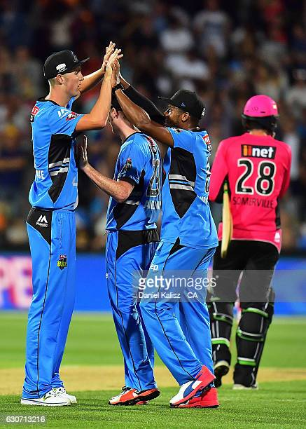 Chris Jordan and Billy Stanlake of the Adelaide Strikers celebrate during the Big Bash League match between the Adelaide Strikers and Sydney Sixers...