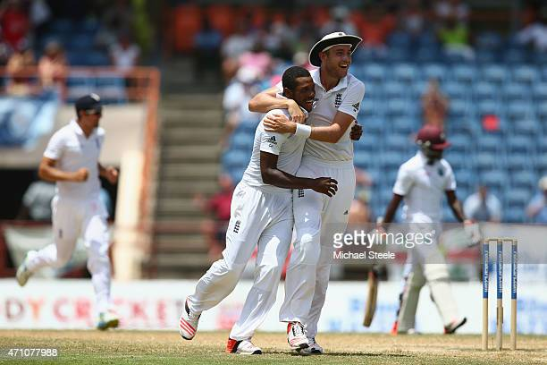 Chris Jordan celebrates with Stuart Broad of England after capturing the wicket of Jermaine Blackwood of West Indies during day five of the 2nd Test...