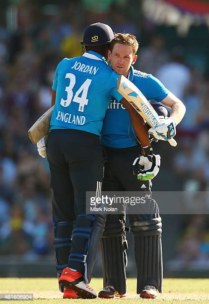 Chris Jordan of England and team mate Eoin Morgan embrace after Morgan scored a century during the One Day International series match between...