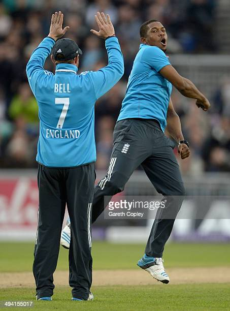 Chris Jordan of England celebrates with Ian Bell taking his 5th wicket of Lasith Malinga of Sri Lanka during the 3rd Royal London One Day...