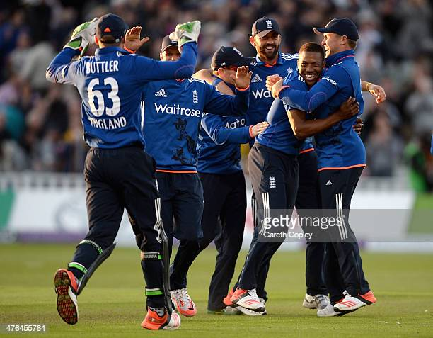 Chris Jordan of England celebrates with teammates after taking the final wicket of Mitchell McClenaghan of New Zealand to win the 1st ODI Royal...