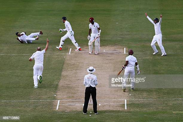 Chris Jordan of England takes a catch at first slip off the bowling of James Tredwell to dismiss Kraigg Braithwaite of West Indies during day two of...
