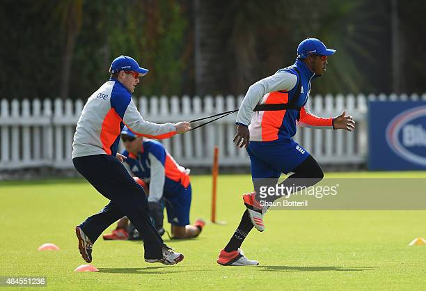 Chris Jordan of England warmsup with captain Eoin Morgan during an England nets session at Basin Reserve on February 27 2015 in Wellington New Zealand