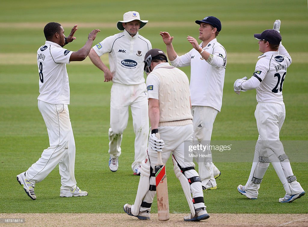 Chris Jordan of Sussex celebrates with team mates (L-R) Ed Joyce, Rory Hamilton-Brown and Ben Brown after dismissing Gary Wilson of Surrey for 124 during day one of the LV County Championship Division One match between Surrey and Sussex at The Kia Oval on April 24, 2013 in London, England.