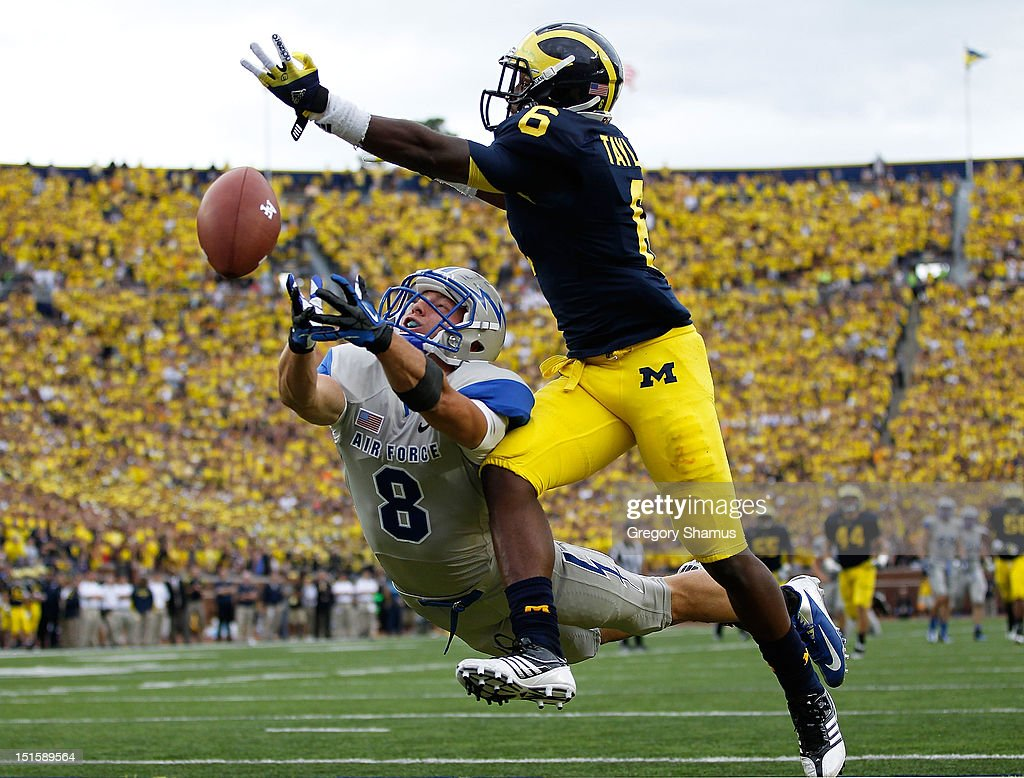 Chris Jordan #8 of the Air Force Falcons can't pull in a third quarter pass under the coverage of Raymon Taylor #6 of the Michigan Wolverines at Michigan Stadium on September 8, 2012 in Ann Arbor, Michigan. Michigan won the game 31-25.