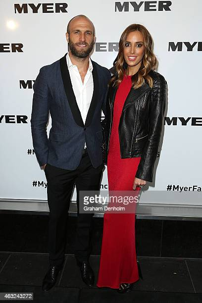 Chris Judd and Rebecca Judd pose as they arrive for the Myer A/W 2015 Season Launch at Myer Mural Hall on February 12 2015 in Melbourne Australia