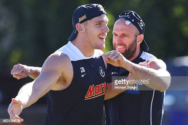 Chris Judd and Tom Bell react during a Carlton Blues AFL preseason training sessions on January 29 2015 in Mansfield Australia