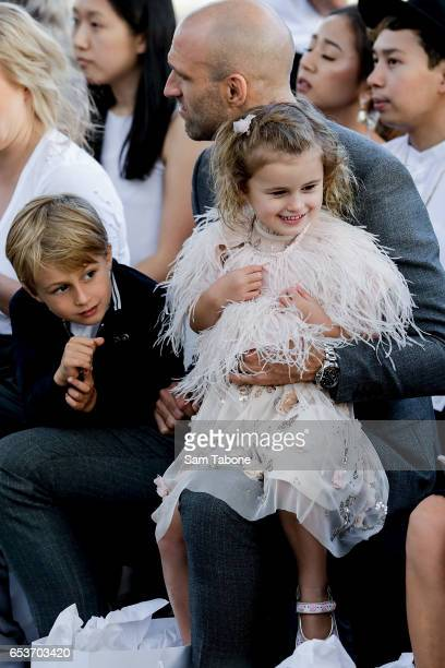 Chris Judd minds kids as Bec Judd showcases designs during the VAMFF 2017 NEXT 'Under The Blade' runway show on March 16 2017 in Melbourne Australia