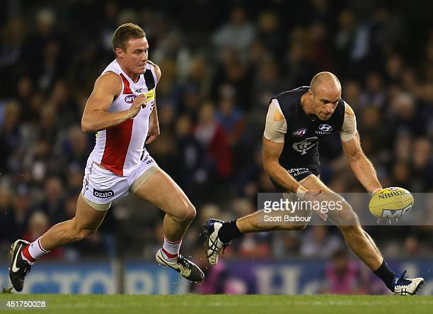 Chris Judd of the Blues competes for the ball during the round 16 AFL match between the Carlton Blues and the St Kilda Saints at Etihad Stadium on...