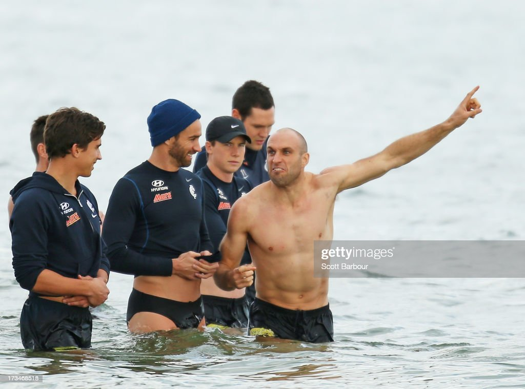 Chris Judd (R) of the Blues gestures as Andrew Walker and Andrew Carrazzo look on during a Carlton Blues AFL Recovery Session at St Kilda Sea Baths on July 15, 2013 in Melbourne, Australia.