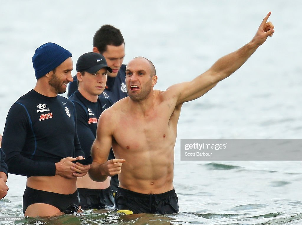 Chris Judd of the Blues gestures as Andrew Walker looks on during a Carlton Blues AFL Recovery Session at St Kilda Sea Baths on July 15, 2013 in Melbourne, Australia.