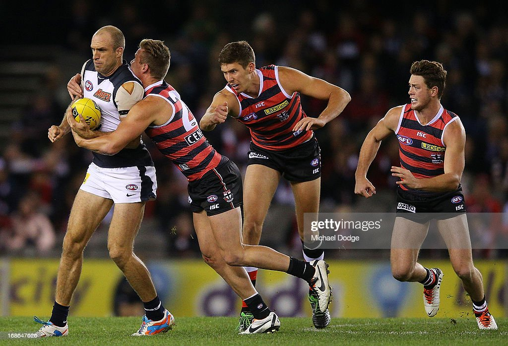 Chris Judd of the Blues gets tackled by David Armitage of the Saints during the round seven AFL match between the St Kilda Saints and the Carlton Blues at Etihad Stadium on May 13, 2013 in Melbourne, Australia.