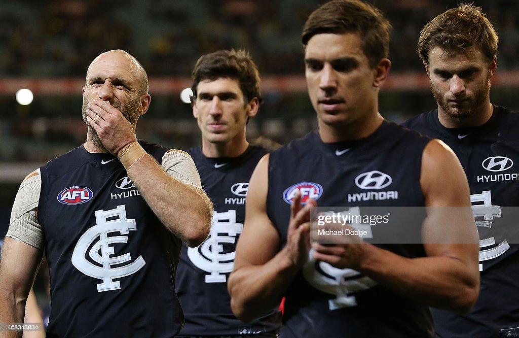 Chris Judd of the Blues (L) reacts after their defeat during the round one AFL match between the Carlton Blues and the Richmond Tigers at Melbourne Cricket Ground on April 2, 2015 in Melbourne, Australia.