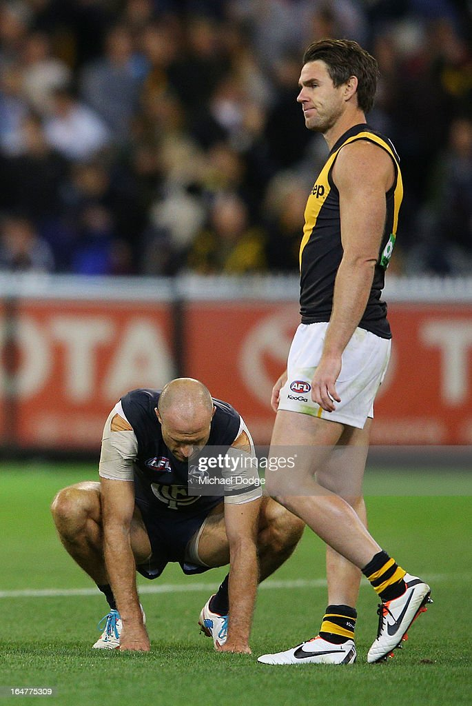 A Chris Judd (L) of the Blues reacts next to Chris Newman of the Tigers after losing during the round one AFL match between the Carlton Blues and the Richmond Tigers at Melbourne Cricket Ground on March 28, 2013 in Melbourne, Australia.