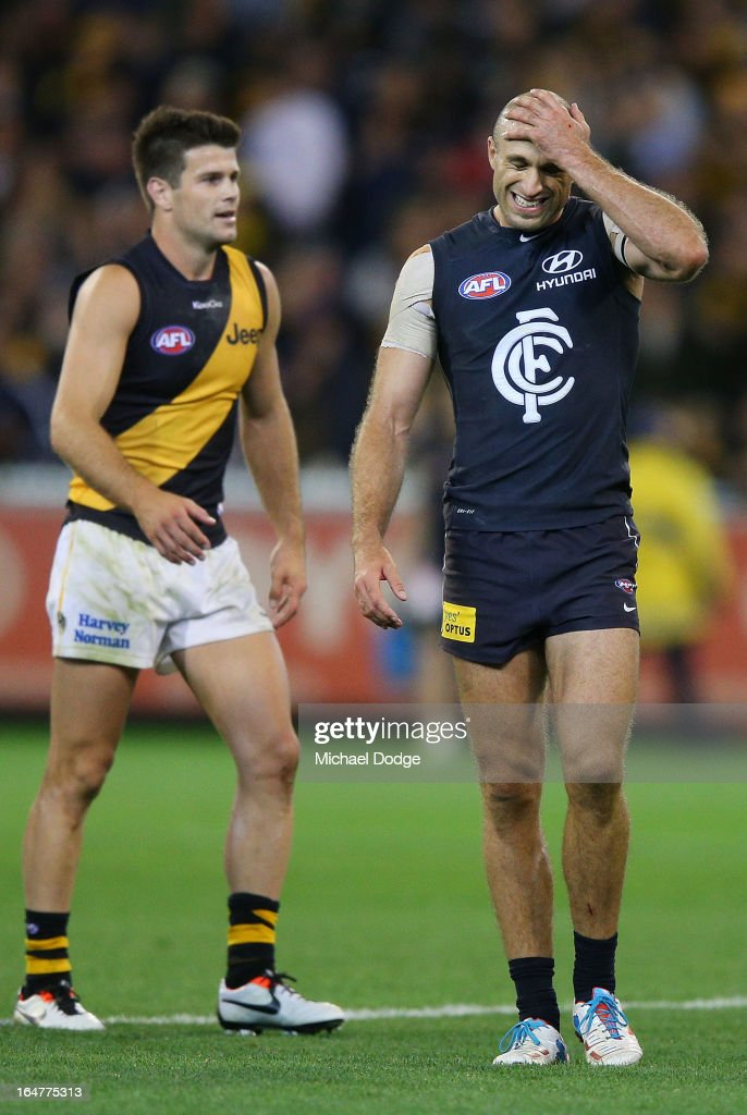 A Chris Judd (R) of the Blues reacts next to Trent Cotchin of the Tigers after losing during the round one AFL match between the Carlton Blues and the Richmond Tigers at Melbourne Cricket Ground on March 28, 2013 in Melbourne, Australia.