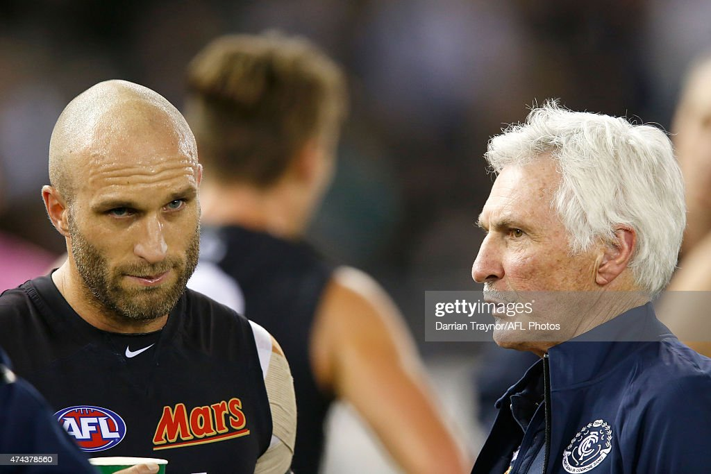 Chris Judd of the Blues speaks with coach Mick Malthouse during the round eight AFL match between the Geelong Cats and the Carlton Blues at Etihad Stadium on May 22, 2015 in Melbourne, Australia.