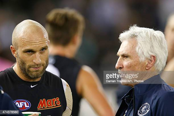 Chris Judd of the Blues speaks with coach Mick Malthouse during the round eight AFL match between the Geelong Cats and the Carlton Blues at Etihad...
