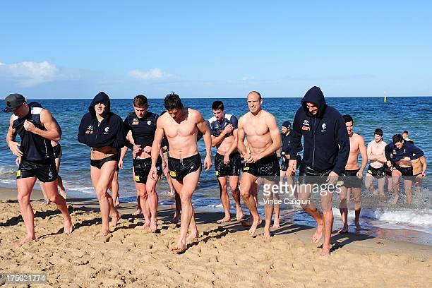 Chris Judd walks out of the water with teammates during a Carlton Blues AFL recovery session at St Kilda Sea Baths on July 30 2013 in Melbourne...