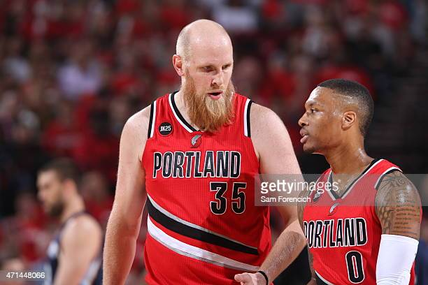Chris Kaman and Damian Lillard of the Portland Trail Blazers speak during a game against the Memphis Grizzlies in Game Three of the Western...