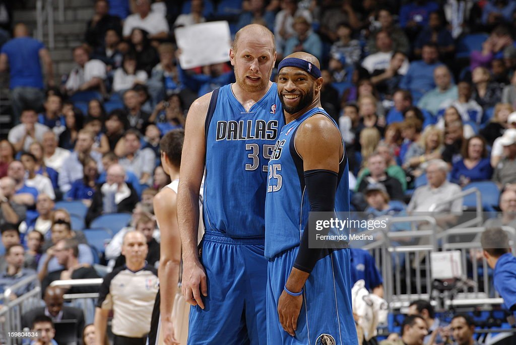 Chris Kaman #35 and Vince Carter #25 of the Dallas Mavericks during the game against the Orlando Magic on January 20, 2013 at Amway Center in Orlando, Florida.