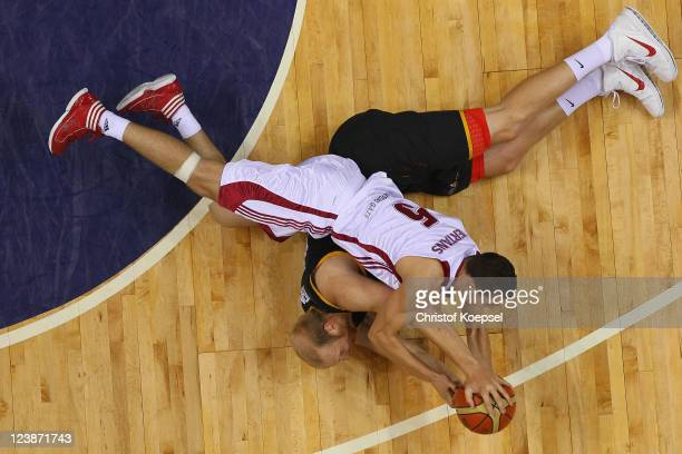 Chris Kaman of Germany and Dairis Bertrans of Latvia fight for the ball during the EuroBasket 2011 first round group B match between Latvia and...